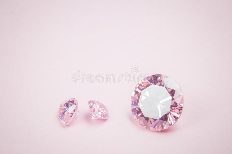 Three pink diamonds macro. Close up of pink diamonds stock photos