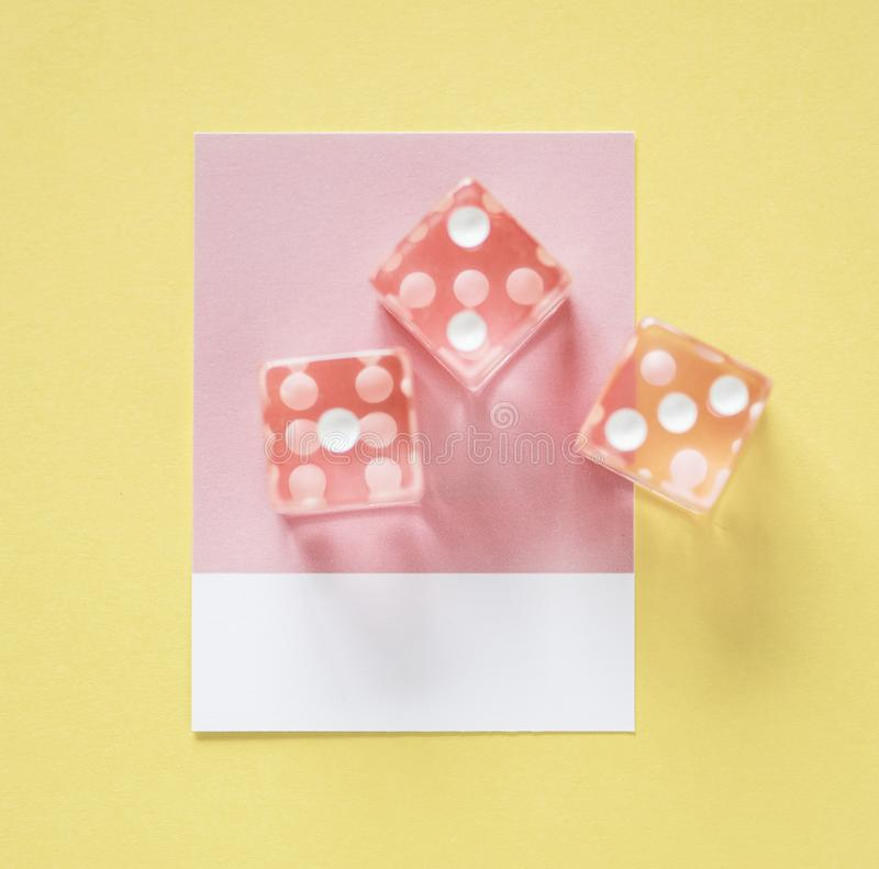 Three Pink Dices stock photography
