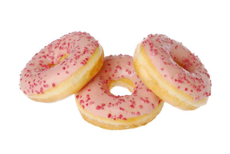 Three pink glazed donuts royalty free stock image