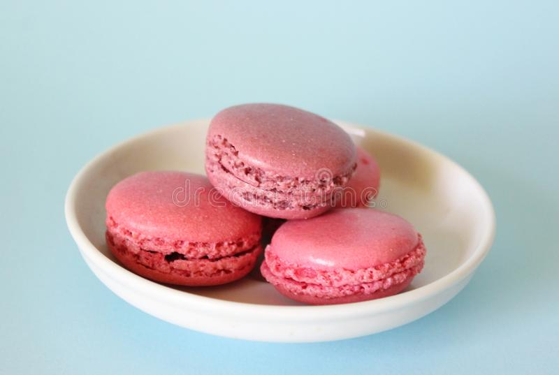Three pink macaroons stock photography