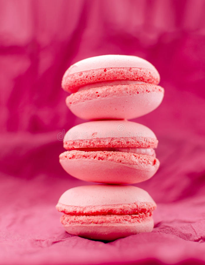 Three pink macaroons stock images