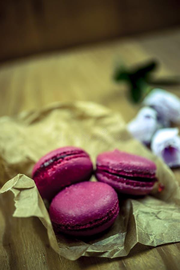 Three pink macaroons stock photos