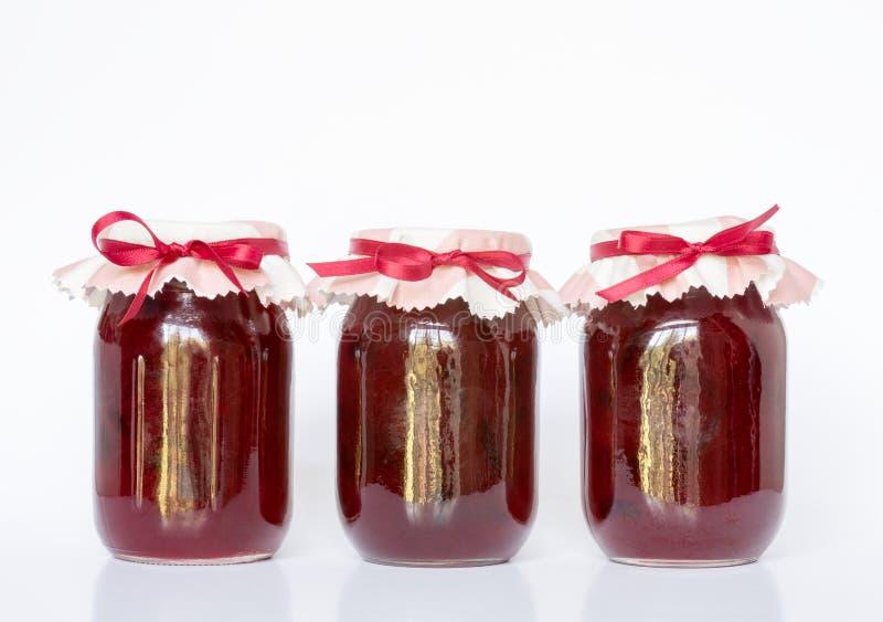 Three Pint Jars of Homemade Plum Jam stock images