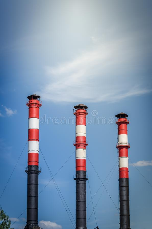 Three pipes of plant against background of blue sky/ three pipes of plant against background of blue sky royalty free stock images