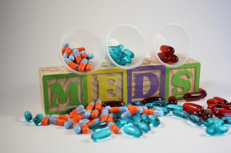 Three Medications on Colorful Blocks stock images