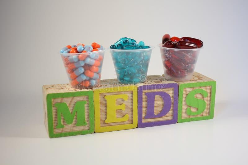 Three Medications on Colorful Blocks stock photos