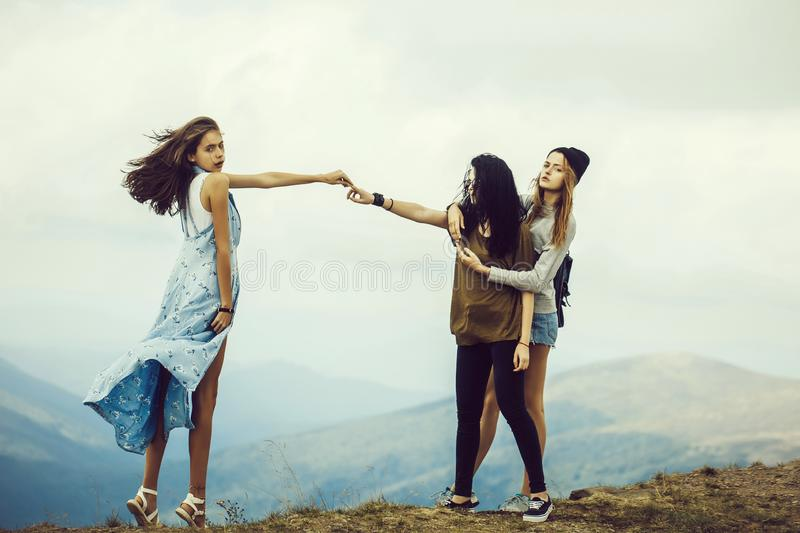 Three pretty girls on mountain stock photography