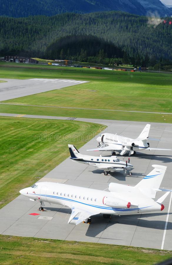 Three private jets parked at Samedan Airport in the upper Engadin stock images