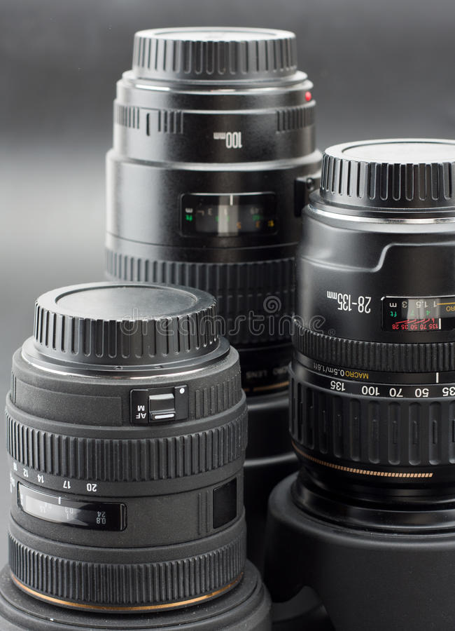 Three professional camera lenses royalty free stock photography