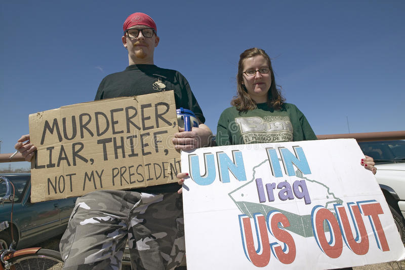 Three protestors in Tucson, AZ of President George W. Bush is holding a sign proclaiming Bush is a Liar and US Out regarding the. Iraq War stock photos