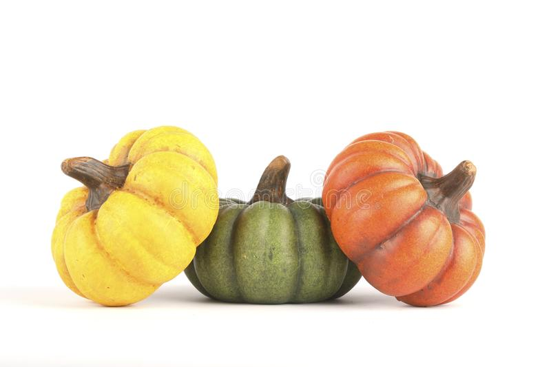 Three pumpkins made of clay stock photography