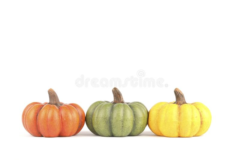 Three pumpkins made of clay stock image