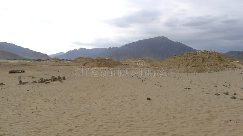 Three pyramids in Caral, north of Lima, Peru. Scenic view of three pyramids in Caral of about 5000 years old. This site was the capital of Caral Civilization royalty free stock image