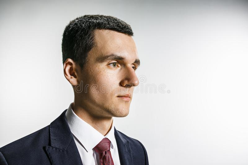 Three-quarter portrait of a businessman with very serious face. Confident professional with piercing look in the stock photo