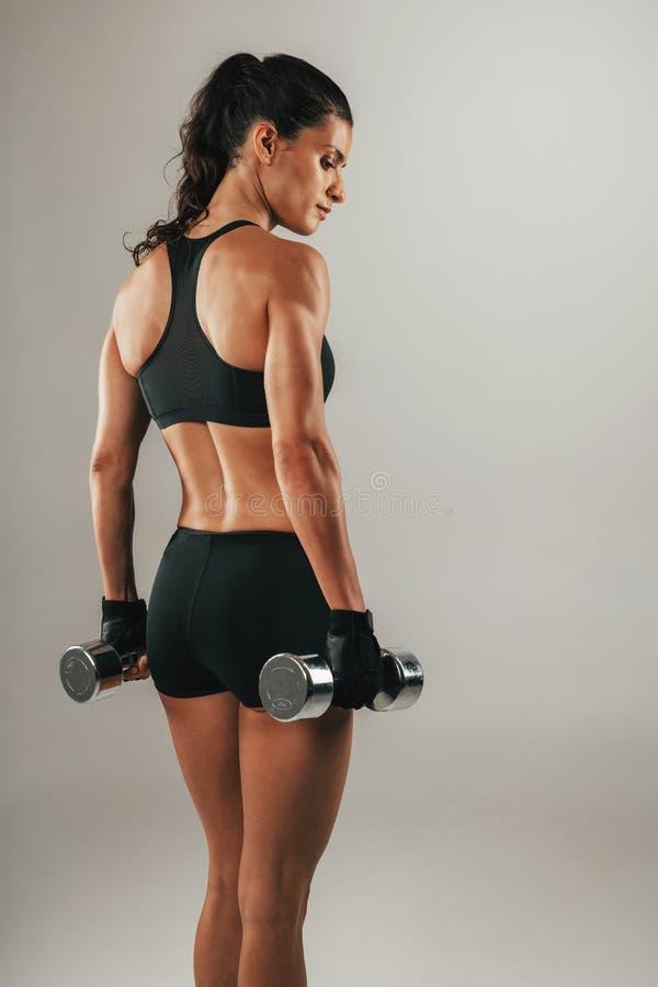 Three quarter view of female bodybuilder stock images