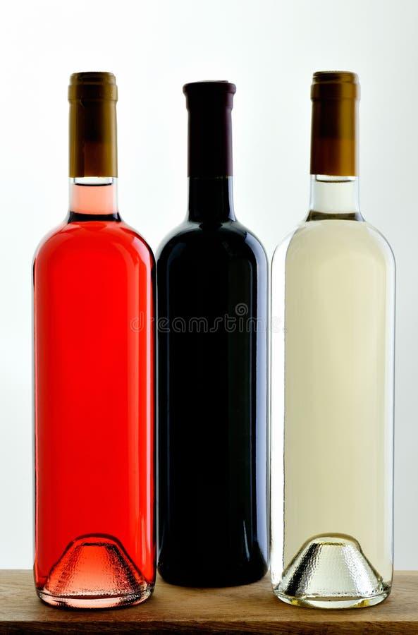 Three random bottles of wine stock images