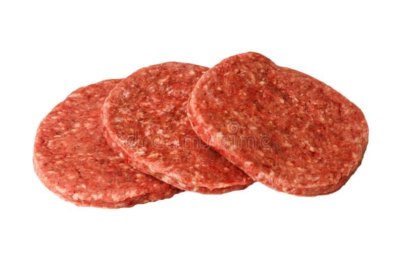 Three raw hamburger patties white background