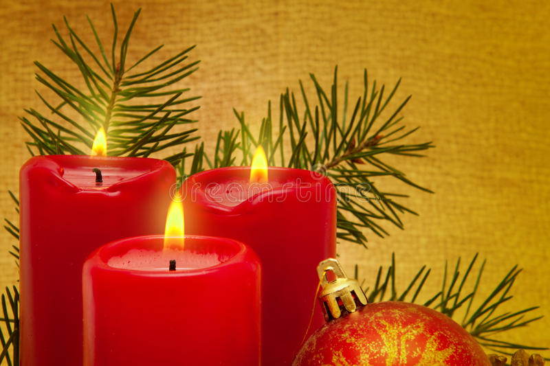 Three red Advent candles. Three advent candles and christmas decoration royalty free stock image