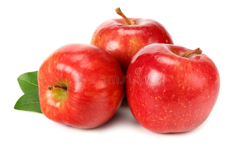 Three red apples with green leaves isolated on white background royalty free stock photos