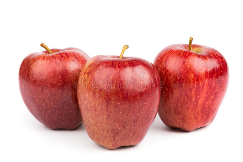 Three red apples isolated stock photos