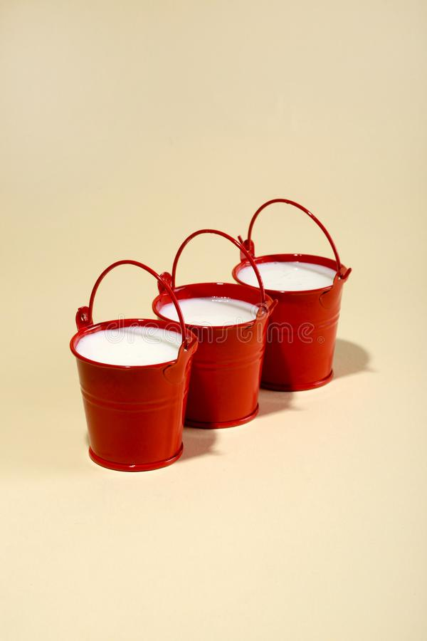 Free Three Red Buckets With Milk Royalty Free Stock Photo - 107271655