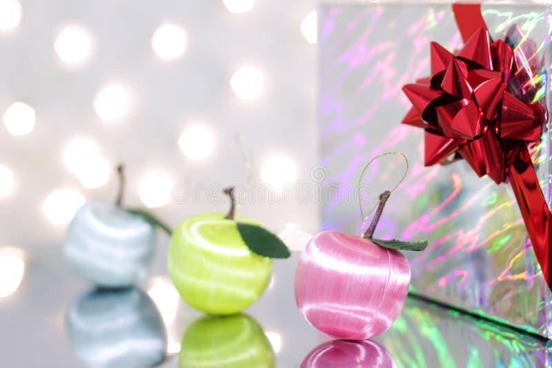 Three red Christmas ball. And gift box stock image