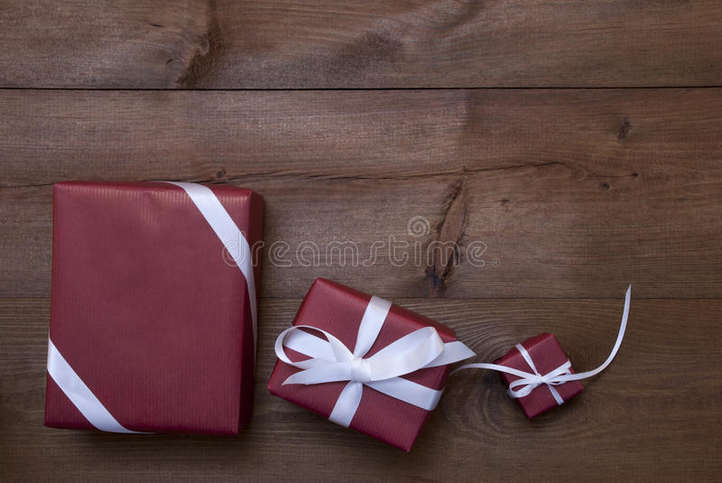 Three Red Christmas Gifts, Presents, White Ribbon, Copy Space. Three Red Christmas Gifts, Presents With White Ribbon As Decoration. Shabby Chic, Rustic, Vintage royalty free stock images