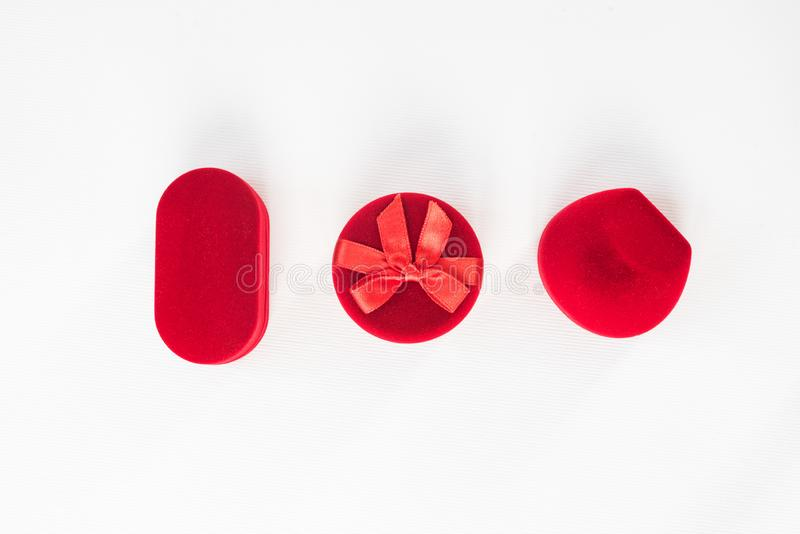 Three red closed jewelry boxes on a white background. Top view.  royalty free stock photo