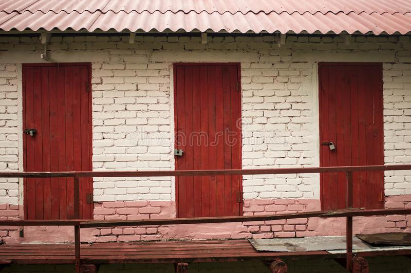 Three red doors. Brick choice for you royalty free stock photography