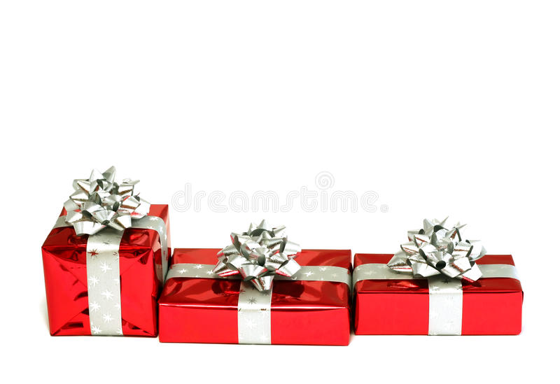 Three red gifts isolated on white. Background stock photography
