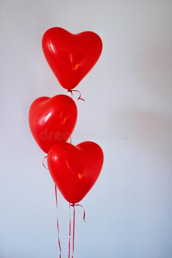 Three Red Heart Balloons stock photo