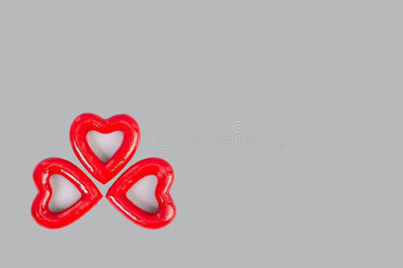 Three red hearts on a gray background with copy space.Ð¡oncept of love, birthday, valentine`s day, all lovers royalty free stock images