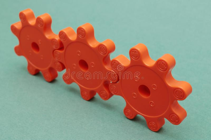 Three red plastic gears royalty free stock photography