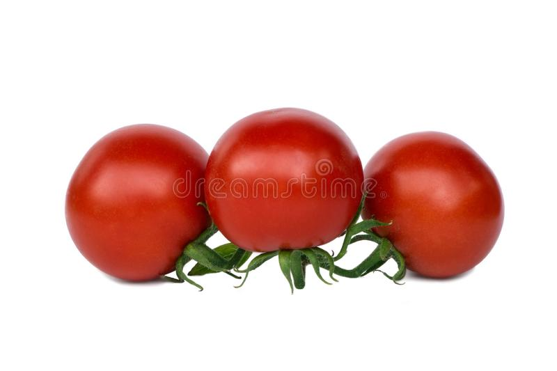 Three red tomatoes isolated on white background stock photography