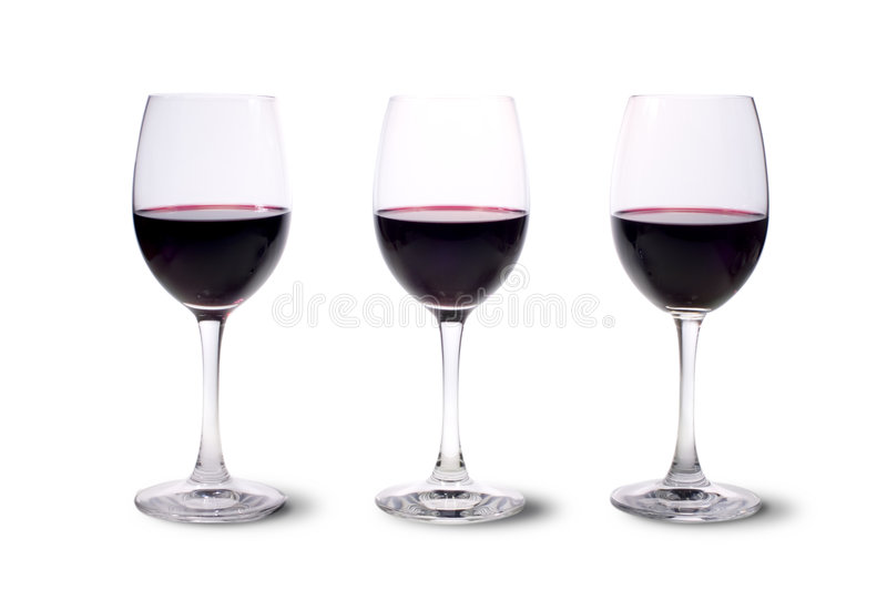 Three red wine glasses royalty free stock photography