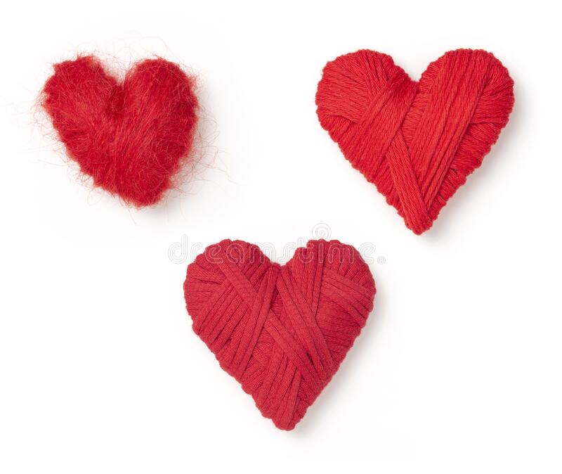 Three red wool hearts stock photo