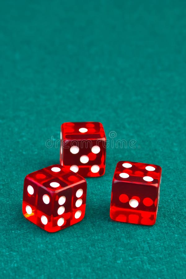 Three reds dice on green royalty free stock images