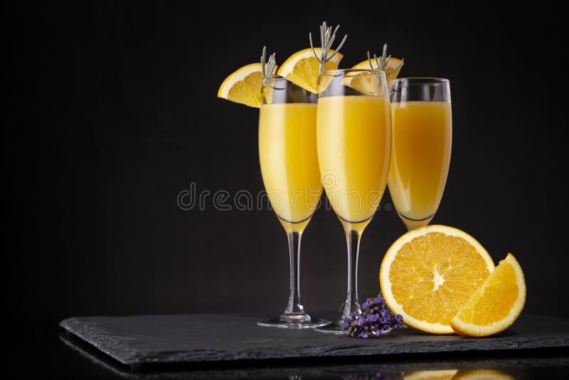 Three refreshing mimosa cocktails stock photos