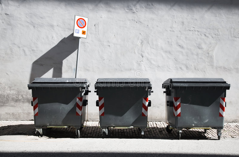 Three refuse bins. Street scene stock photography