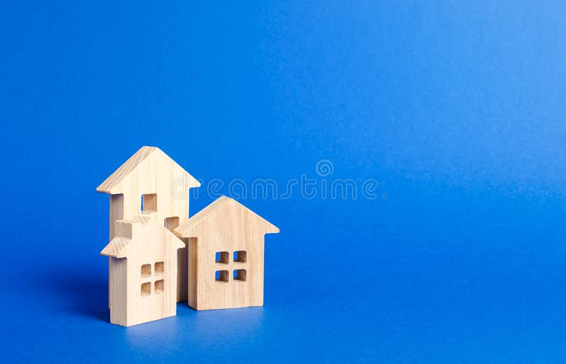Three residential buildings figurine. The concept of buying and selling real estate, renting. Search for a Apartment house. Affordable housing, credit and royalty free stock photos