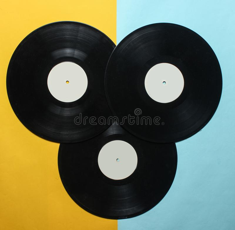 Three retro vinyl records on a colored pastel background. Top View. royalty free stock photography