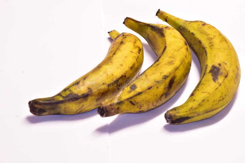 Three ripe plantains on a table royalty free stock photography