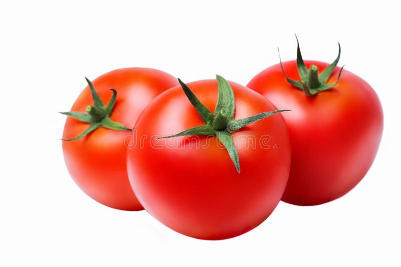 Three ripe red tomatoes on white isolate background, closeup stock images