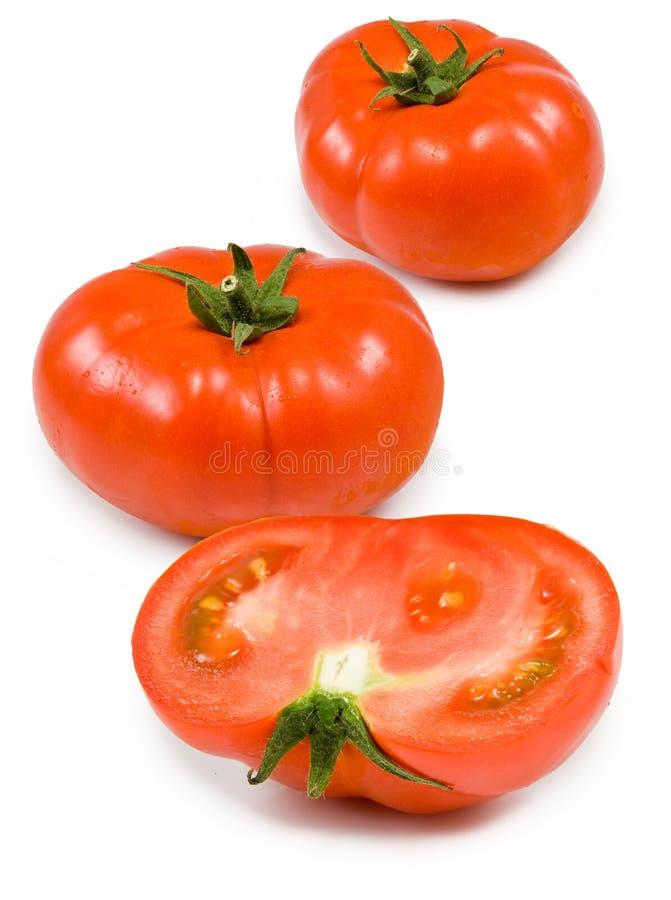 Three ripe tomatoes on white background stock photo