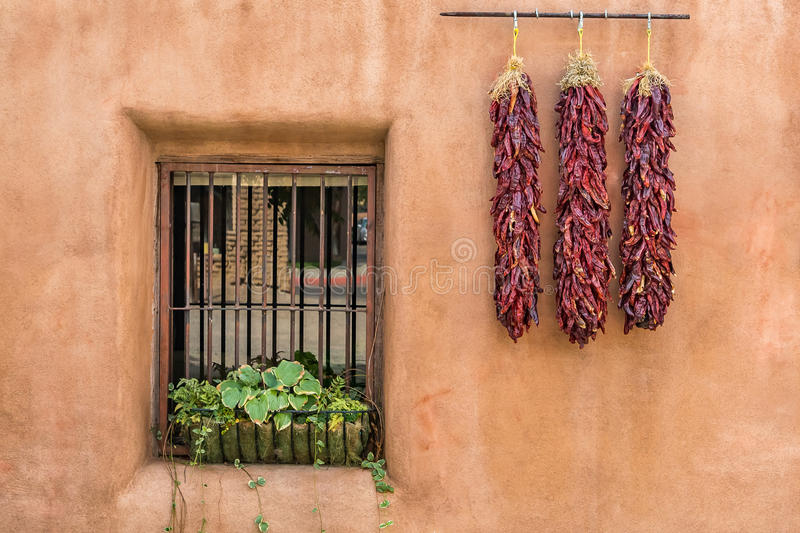 Three ristras on adobe royalty free stock image