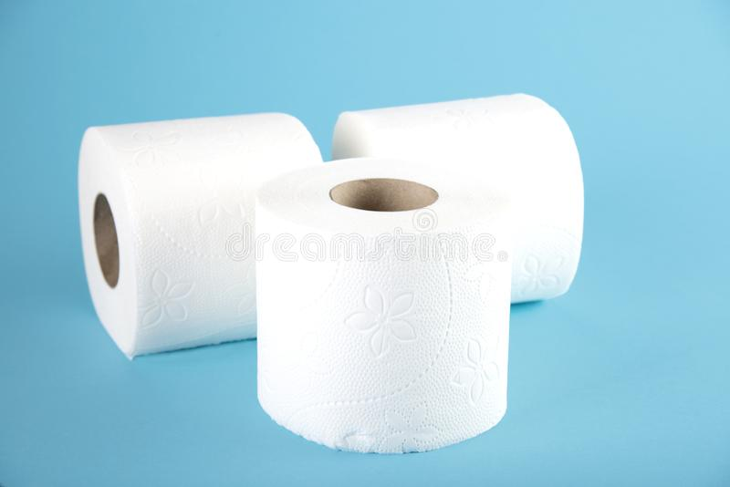 Three rolls of white toilet paper on a colored background stock images