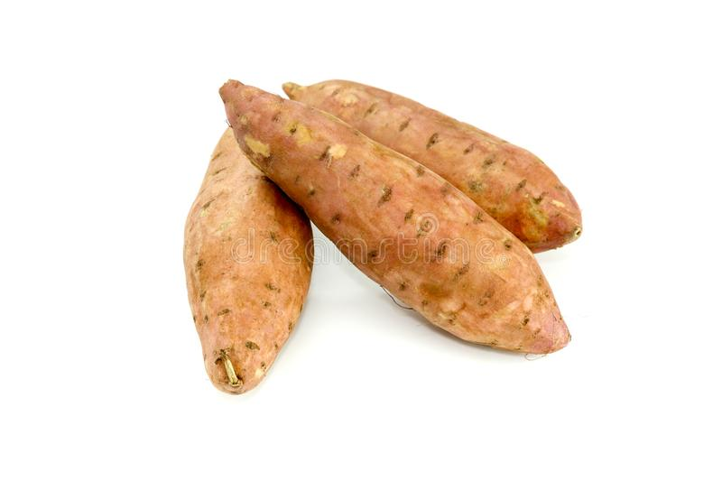 Three root vegetables sweet potato on white background stock images