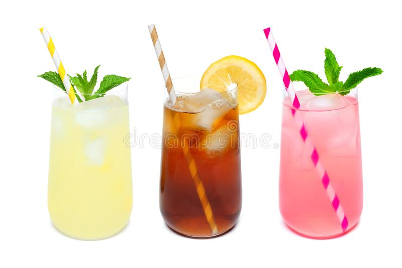 Three rounded glasses of summer drinks isolated on white. Three rounded glasses of summer lemonade, iced tea, and pink lemonade drinks with straws isolated on a stock image
