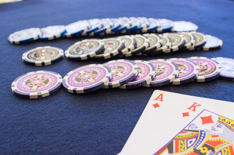 Three Rows of Chips near Playing Cards stock photography