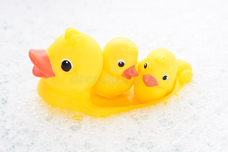 Download Three Rubber Ducks In Foam Water Stock Image - Image: 4264491
